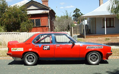 LX Torana race car parked in the street