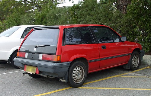 Red Honda Civic Gen 3 hatchback