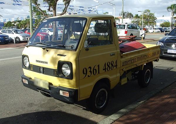 Yellow 1980's Suzuki Pickup