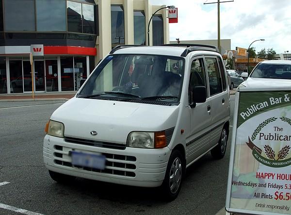 1995 white Daihatsu Move