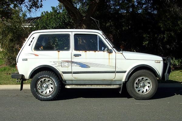 White Lada Niva suffering from rust