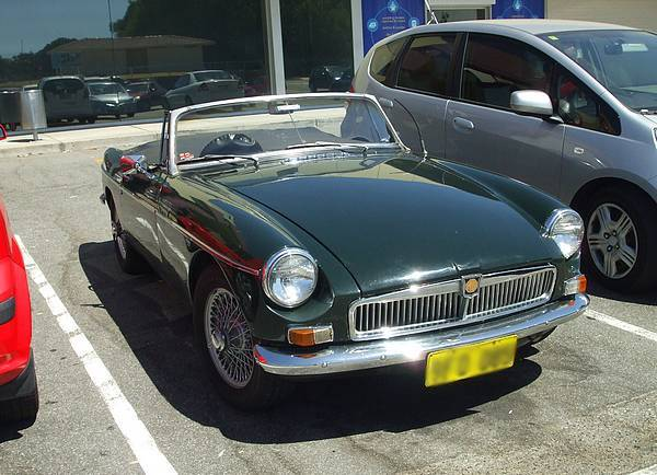Dark green MGB with overdrive