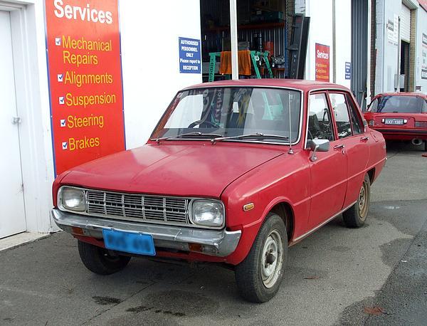 Red Mazda 1300 Deluxe
