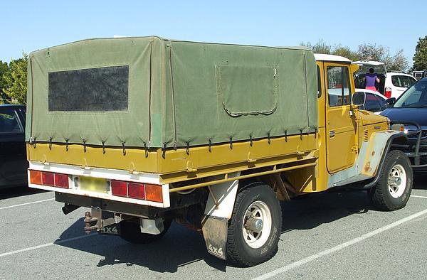 Yellow Toyota Landcruiser HJ45
