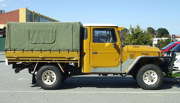Yellow Toyota Landcruiser HJ45