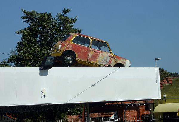 Morris Mini 850 on the roof of Trade Car Wholesale Albany Highway East Victoria Park