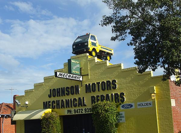 Daihatsu pick up on the roof of Johnson Motors Mechanical Repairs East Victoria Park
