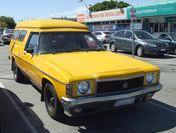 Yellow HX Holden Panelvan