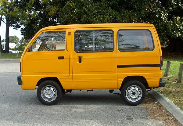 Yellow Suzuki Carry Van