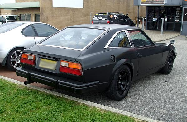 Datsun 280ZX completely black and debadged.