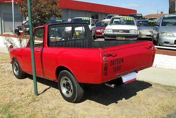 Red Datsun 1000 ute