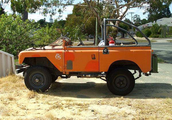 Orange Land Rover Short Wheel Base