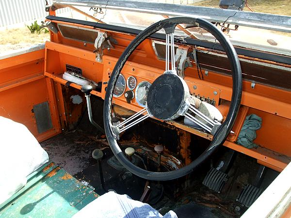 Orange Land Rover Short Wheel Base