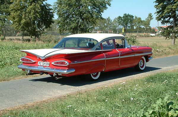 Red 1959 Chevrolet Bel Air 4 door sedan