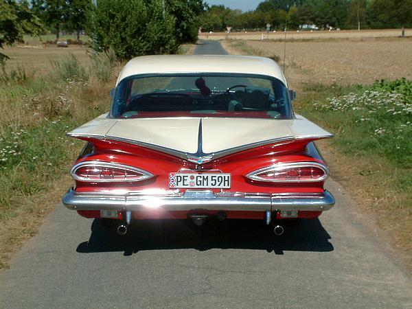 Red 1959 Chevrolet Bel Air 4 door sedan