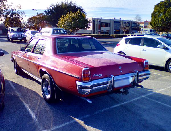 Holden HX Statesman. The Deville wears Red.
