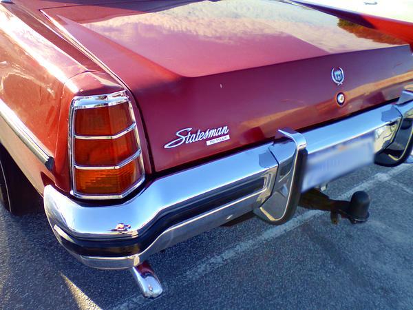 Red Holden HX Statesman Deville